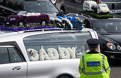 © Licensed to London News Pictures. 03/05/2018. Swanley, UK. Police watch as The funeral procession of burglar Henry Vincent leaves Swanley to head to a service in St Mary Cray, Bromley, London. Henry Vincent, who is part of a traveller community in the south east London, died during an attempted burglary of the home of pensioner Richard Osborn-Brook in Hither Green. Photo credit: Ben Cawthra/LNP