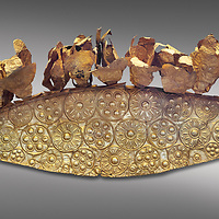 Mycenaean Gold diadem from Grave III, 'Grave of a Women', Grave Circle A, Myenae, Greece. National Archaeological Museum Athens. Grey Background<br /> <br /> An impressive Mycenaean gold diadem with repousse rosettes and thin sheets applied to the top. .Cat No 1. 16th century BC.<br /> <br /> Shaft Grave III, the so-called 'Grave of the Women,' contained three female and two infant interments. The women were literally covered in gold jewelry and wore massive gold diadems, while the infants were overlaid with gold foil.