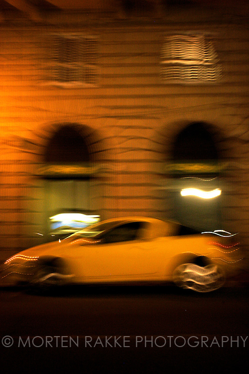 Car in street, by night in Florence, Italy