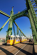 Trams on the Liberty or Freedom Bridge (Szabadság híd,). Budapest, Hungary .<br /> <br /> Visit our HUNGARY HISTORIC PLACES PHOTO COLLECTIONS for more photos to download or buy as wall art prints https://funkystock.photoshelter.com/gallery-collection/Pictures-Images-of-Hungary-Photos-of-Hungarian-Historic-Landmark-Sites/C0000Te8AnPgxjRg