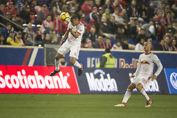 March 1, 2018 - Harrison, New Jersey, United States - New York Red Bulls midfielder TYLER ADAMS (4) heads the ball while New York Red Bulls defender AURELIEN COLLIN (78) looks on during the CONCACAF Champions league match at Red Bull Arena in Harrison, NJ.  NY Red Bulls defeat CD Olimpia 2-0  (Credit Image: © Mark Smith via ZUMA Wire)