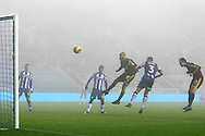 Ipswich's David McGoldrick (10) rises through the fog to head the winning goal 2-3 during the EFL Sky Bet Championship match between Wigan Athletic and Ipswich Town at the DW Stadium, Wigan, England on 17 December 2016. Photo by Craig Galloway.