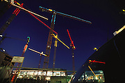 Berlin, Germany. Construction cranes with colored neon lights.