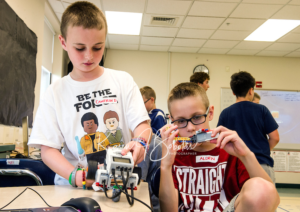Cameron and Alden add a lift to their droid during Let Go Your Mind summer camp with Gilford Parks and Recreation at the Gilford Middle School on Wednesday.  (Karen Bobotas/for the Laconia Daily Sun)