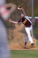 Kennedy Catholic shortstop Jeremy Branca kicks up second base as he stretches to grab a throw from the outfield during a game against the West Middlesex Big Reds.