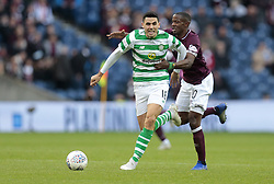 Heart of Midlothian's Arnaud Djoum battle for the ball with Celtic's Tom Rogic (L) during the Betfred Cup semi final match at BT Murrayfield Stadium, Edinburgh. PRESS ASSOCIATION Photo. Picture date: Sunday October 28, 2018. See PA story SOCCER Hearts. Photo credit should read: Graham Stuart/PA Wire. EDITORIAL USE ONLY