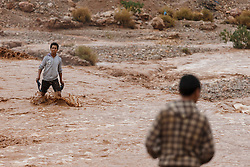 People observing river crossing during flood at Ait Snan on road to Todra Gorge, Morocco