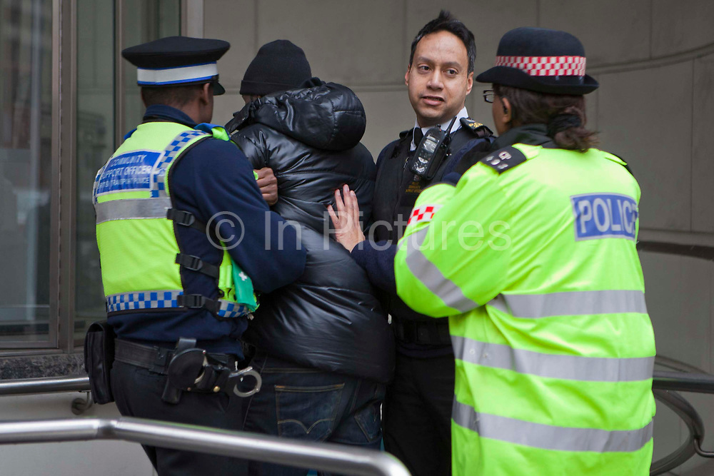 A young black male is arrested on Ludgate Hill. It took 10 officers from various forces to overcome this man and arrest him securely. Community Support Officers, city of London Police and the Metropolitan Police.