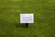 No sitting on the grass sign as the Coronavirus lockdown measures are set to ease further, and the quiet city starts coming to an end on 22nd June 2020 in London, England, United Kingdom. As of today the government has relaxed its lockdown rules, and is allowing some non-essential shops to open with individual shops setting up social distancing queueing systems.