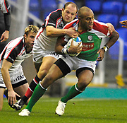 """Reading; GREAT BRITAIN; Sailosi TAGICKIBAU; Tackled by Rory BEST,  during the third round Heineken Cup game; London Irish vs Ulster Rugby; at the Madejski Stadium; Reading ENGLAND; Sat 09.12.2006. [Photo Peter Spurrier/Intersport Images]<br /> <br /> """""""
