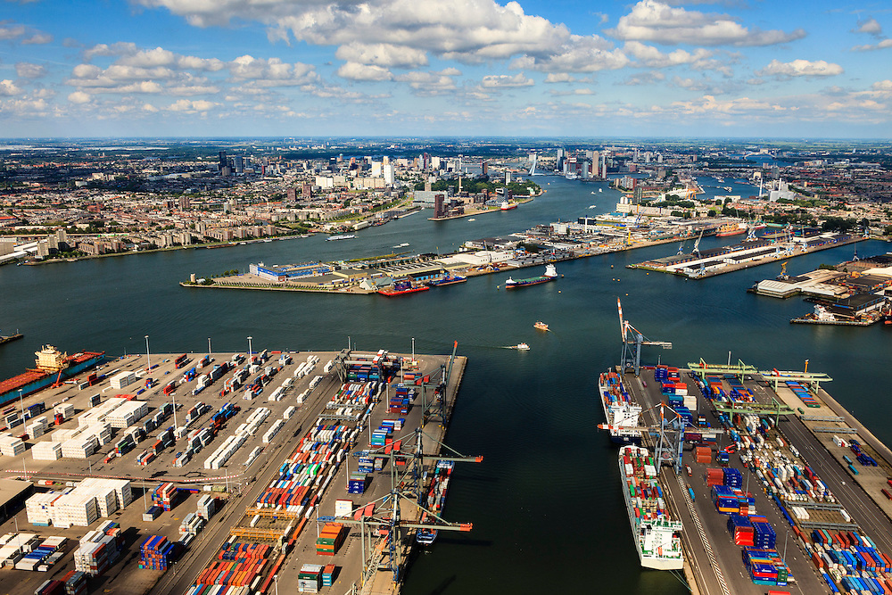 Nederland, Zuid-Holland, Rotterdam, 15-07-2012; Waalhaven met containerterminals en containeroverslag. Binnenstad Rotterdam in de achtergrond..Container storage and transshipment Waalhaven (Waal harbour) of the Port of Rotterdam, center in the back...luchtfoto (toeslag), aerial photo (additional fee required).foto/photo Siebe Swart