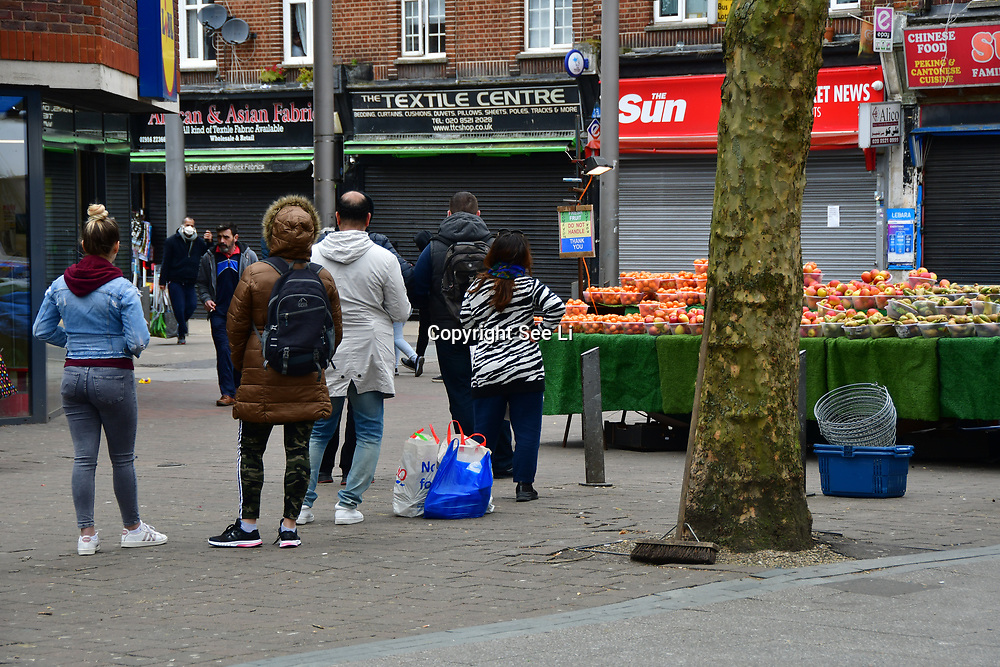 During the coronavirus in UK lockdown mostly european people queue outside Lidl Supermarket for shopping for food,on 28 March 2020, at Walthamstow Market, London.