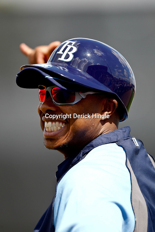 March 8, 2011; Port Charlotte, FL, USA; Tampa Bay Buccaneers wide receiver coach Eric Yarbs serving as a guest first base coach during a spring training exhibition game against the Toronto Blue Jays at Charlotte Sports Park.   Mandatory Credit: Derick E. Hingle