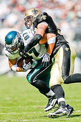Philadelphia Eagles tight end Brent Celek #87 carries the ball with New Orleans Saints linebacker Scott Shanle #58 defending during the NFL game between the New Orleans Saints and the Philadelphia Eagles on September 20th 2009. The Saints won 48-22 at Lincoln Financial Field in Philadelphia, Pennsylvania. (Photo By Brian Garfinkel)