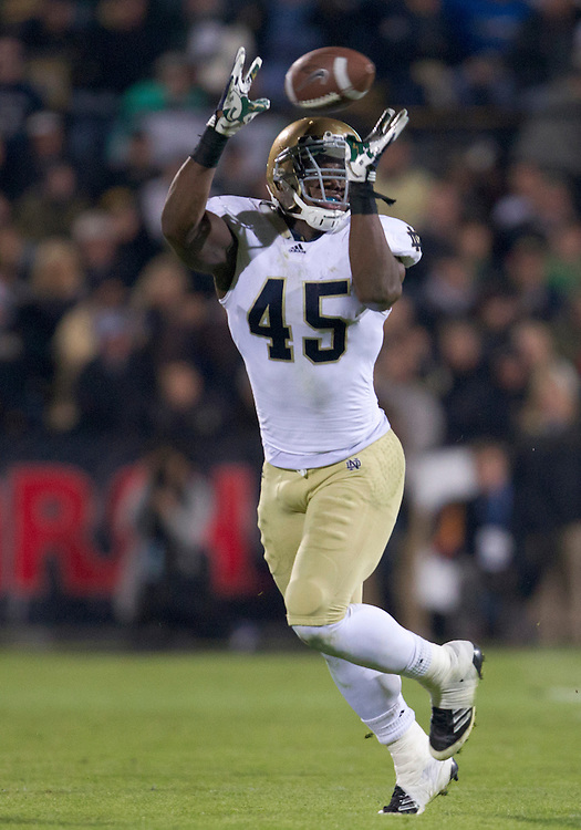 October 01, 2011:  Notre Dame outside linebacker Darius Fleming (#45) drops interception attempt during NCAA Football game action between the Notre Dame Fighting Irish and the Purdue Boilermakers at Ross-Ade Stadium in West Lafayette, Indiana.  Notre Dame defeated Purdue 38-10.