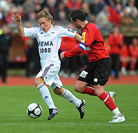Fotball NM Cup Stjørdalsblink - Rosenborg<br /> Øverlands Minde, Stjørdal 13 mai 2010<br /> <br /> Jonas Svensson, Rosenborg med ballen. Til høyre : Håvard Fuglem, Stjørdalsblink<br /> <br /> Foto : Arve Johnsen, Digitalsport