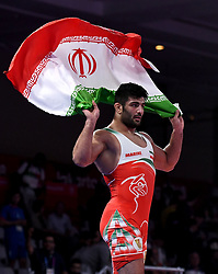 Jakarta, Aug 19,2018  Alireza Karimimachiani of Iran celebrates after winning Men's Wrestling Freestyle 97 kg Final against Magomed Musaev of Kyrgyzstan at the 18th Asian Games at Jakarta, Indonesia, Aug. 19, 2018. (Credit Image: © Yue Yuewei/Xinhua via ZUMA Wire)