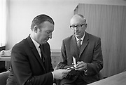 Presentation of New Decimal Coins to Charlie Haughey TD, Minister for Finance, by Dr. T. K. Whitaker, Governor of the Central Bank, at Fitzwilton House..03.09.1969, T.K. Whitaker