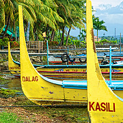 Tour boats sit on the banks of the Taal Lake Yacht Club, waiting to ferry passengers to volcano island.