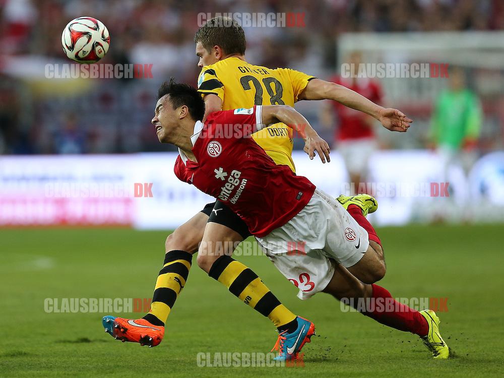 FOOTBALL: Shinji Okazaki (1. FSV Mainz 05) is tackled by Matthias Ginter (Borussia Dortmund) during the Bundesliga match between 1. FSV Mainz 05 and Borussia Dortmund at Coface Arena on September 20, 2014 in Mainz, Germany. Photo: Claus Birch.