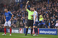 Wycombe Wanderers Defender, Jason McCarthy (26) shown a yellow card during the EFL Sky Bet League 1 match between Portsmouth and Wycombe Wanderers at Fratton Park, Portsmouth, England on 22 September 2018.