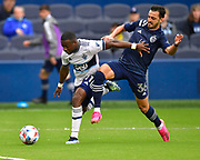 May 16, 2021 - Kansas City, KS, United States:  Vancouver Whitecaps forward Cristian Dajome (11, left) and Sporting Kansas City defender Luis Martins (36) vie for the ball.  Sporting KC beat the Vancouver Whitecaps FC 3-0 in a Major League Soccer game. <br /> Photo by Tim Vizer/Polaris