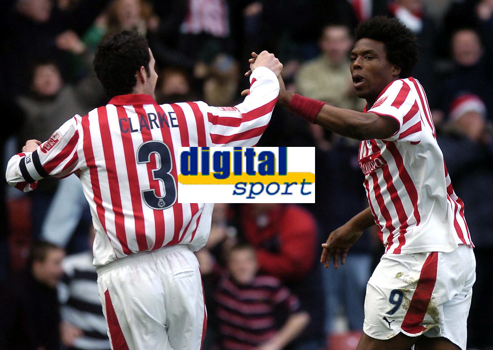 Photo. Glyn Thomas. <br /> Stoke City v Sheffield United. <br /> Coca Cola Championship. 12/03/2005.<br /> Stoke's Gifton Noel-Williams (R) celebrates with Clive Clarke after scoring the first of his goals.