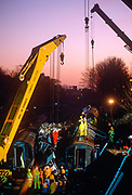 Cranes and lifting equipment raise wreckage from a train carriage after the Clapham rail disaster at Wandsworth, on 12th December 1988, in London, England.