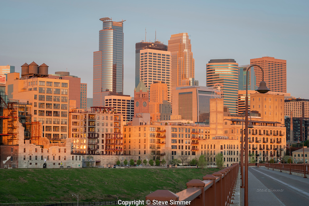 First light of day on the skyscrapers and the streets still in shadows. From the Stone Arch Bridge, ten minutes after sunrise.