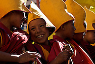 Young monks share a laugh at the Thiksey Monastery in Ladakh, India during an annual masked dance performance.