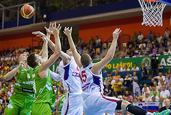 Edo Muric of Slovenia and Gasper Vidmar of Slovenia during friendly match between National teams of Slovenia and Serbia for Eurobasket 2013 on August 3, 2013 in Arena Zlatorog, Celje, Slovenia. Slovenia derated Serbia 67-52. (Photo by Vid Ponikvar / Sportida.com)