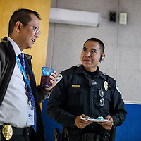 New acting Chief of Police Franklin Boyd, left, chats with Gallup Police officer Joe Roanhorse during a reception for Boyd's promotion Friday at the Gallup Police headquarters.