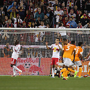 Ibrahim Sekagya, (left), New York Red Bulls, reacts after his defensive error led to a Houston goal during the New York Red Bulls V Houston Dynamo, Major League Soccer second leg of the Eastern Conference Semifinals match at Red Bull Arena, Harrison, New Jersey. USA. 6th November 2013. Photo Tim Clayton