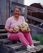 Margaret M. Marlin with fine grass basket that she made, village of Stebbins on the shore of Norton Sound, Alaska.