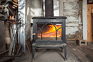 The warm glow of the woodstove takes the chill off a November dune shack stay.
