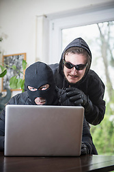 Hackers stealing data from laptop