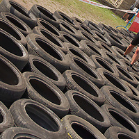 Competitor runs through a tyre obstacle during the Brutal Run extreme obstacle course race in Budapest, Hungary on August 30, 2014. ATTILA VOLGYI