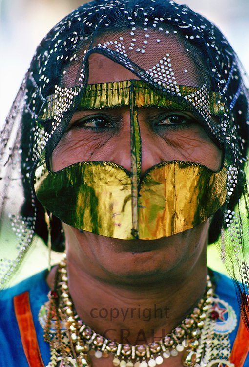 A Bedouin woman wearing traditional headgear and asaba headcovering , Abu Dhabi