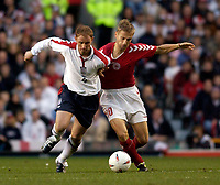 Photo. Jed Wee.<br /> England v Denmark, International Friendly, Old Trafford, Manchester. 16/11/03.<br /> England's Nicky Butt (L) takes on Denmark's Martin Jorgensen.