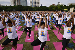 June 18, 2017 - Bangkok, Bangkok, Thailand - Thousands of people participate in a yoga exercise at Chulalongkorn University field, marking the International Day of Yoga in Bangkok, Thailand. June 18, 2017.  International Day of Yoga event at Chulalongkorn University aims to promote yoga as a way to improve physical strength, flexibility and mental well-being it was an to join the people across the globe to celebrate the health benefits and peace of the ancient Indian traditon. (Credit Image: © Anusak Laowilas/NurPhoto via ZUMA Press)