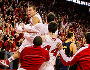 Wisconsin's Ben Brust celebrates making a 3-point basket to tie the game at the buzzer and forcing the game into overtime.