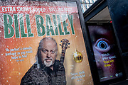 A poster for musician and comedy entertainer Bill Bailey alongside an ad campaign urging drivers to slow down for the sake of the public's safety, on 24th February 2021, in London, England.