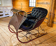 Fancy Cutter horse-drawn sleigh (circa 1885) made by Leduc of Canada. Shelburne Museum is one of the finest, most diverse, unconventional museums of American folk art. Visit this extensive museum in the town of Shelburne, near Lake Champlain, in Vermont, USA. Over 150,000 works are exhibited in 38 buildings, 25 of which are historic (relocated from New England and New York). See impressionist paintings, American paintings, artifacts of the 1600s-1900s, folk art, quilts and textiles, carriages, furniture, a lighthouse, covered bridge, and 220-foot steamboat Ticonderoga. Electra Havemeyer Webb, an avid collector of American folk art, founded the Museum in 1947.