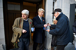 """© Licensed to London News Pictures. 10/11/2018. London, UK. JO JOHNSON MP and his father STANLEY JOHNSON sign autographs as they leave BBC Broadcasting House in London after JO JOHNSON resigned as transport minister yesterday. Mr Johnson, brother of former foreign secretary Boris Johnson, resigned his ministerial post saying it's """"imperative we go back to the people and check"""" they still want to leave. Photo credit: Ben Cawthra/LNP"""