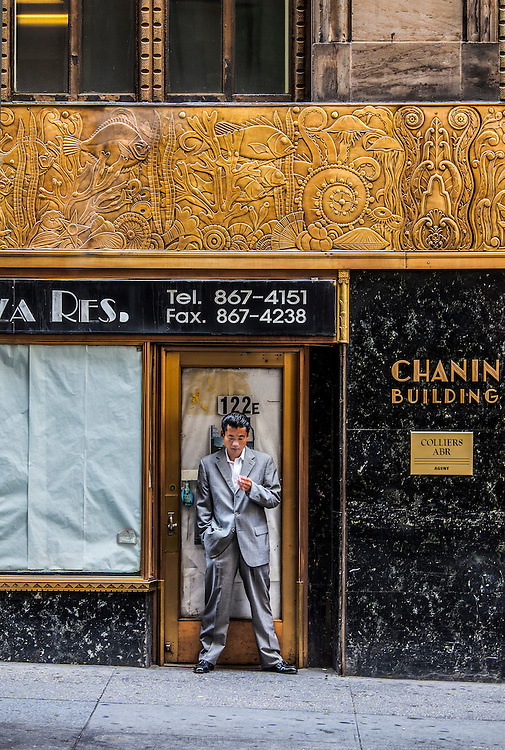 The 41st Street, rear facade of the oft-overlooked Chanin Building, one of New York's greatest Art Deco treasures.<br /> <br /> The bronze frieze depicts evolution, and it encircles the building's second floor, while the ground floor is sheathed in black Belgian marble.