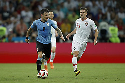 (L-R) Nahitan Nandez of Uruguay, Adrien Silva of Portugal during the 2018 FIFA World Cup Russia round of 16 match between Uruguay and at the Fisht Stadium on June 30, 2018 in Sochi, Russia