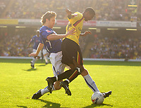 Photo: Daniel Hambury.<br />Watford v Leicester City. Coca Cola Championship.<br />15/10/2005.<br />Watford's Ashley Young and Leicester's Nils-Eric Johansson battle for the ball.