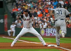 April 30, 2018 - Houston, TX, U.S. - HOUSTON, TX - APRIL 30:  Houston Astros first baseman Yuli Gurriel (10) gets an out on New York Yankees center fielder Aaron Hicks during the baseball game between the New York Yankees and Houston Astros on April 30, 2018 at Minute Maid Park in Houston, Texas.  (Photo by Leslie Plaza Johnson/Icon Sportswire) (Credit Image: © Leslie Plaza Johnson/Icon SMI via ZUMA Press)