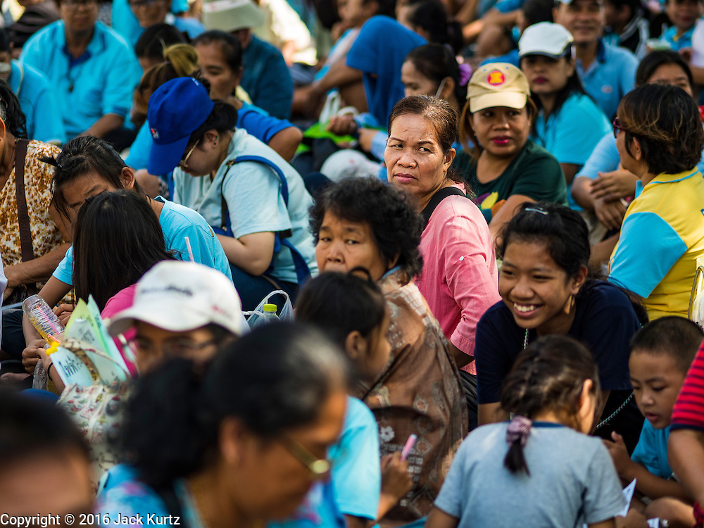 03 OCTOBER 2016 - BANGKOK, THAILAND:  Slum dwellers from across Thailand sit in front of the UN headquarters in Bangkok during a World Habitat Day protest. In 1985, the UN General Assembly declared that World Habitat Day would be observed on the first Monday of October every year.  The declaration noted that every person deserves a decent place to live. In Bangkok this year, hundreds of people marched to the United Nations' offices to deliver a letter addressed to the UN Secretary General noting that forced evictions to facilitate urban renewal and gentrification was resulting in an increase in homelessness and substandard housing. Protesters and housing rights' activists also marched to the Prime Minister's Office and Bangkok city hall to express their concerns.     PHOTO BY JACK KURTZ