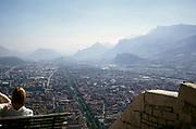 Oblique aerial view over city centre from castle Bastille,  Grenoble, France 1974